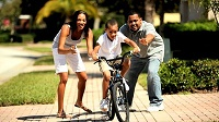 stock-footage-african-american-boy-riding-his-bicycle-in-first-time